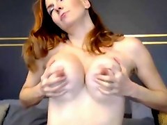 Tall redhead massages her clit