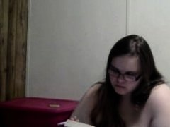 Nerdy girl smokes naked while reading in bed