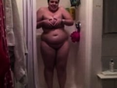 Chubby chick getting naked in the shower