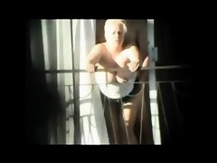Spying Exhib Neighbour Fucking on Balcony