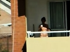 girl sunbathing topples un bacony in argentina.